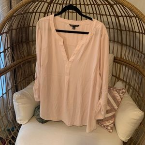Blush colored career top with pleated back